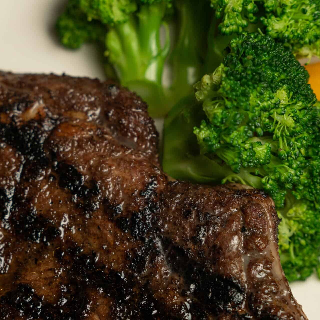 Juicy steak with gill marks and a fresh green broccoli side